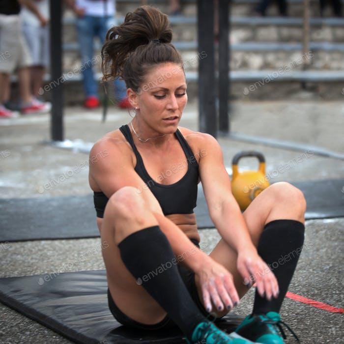 Women doing sit-ups at a cross training competition