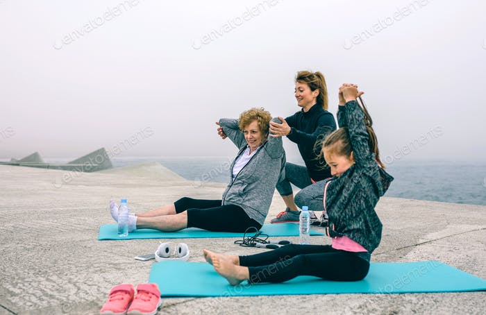 Three female generations exercising