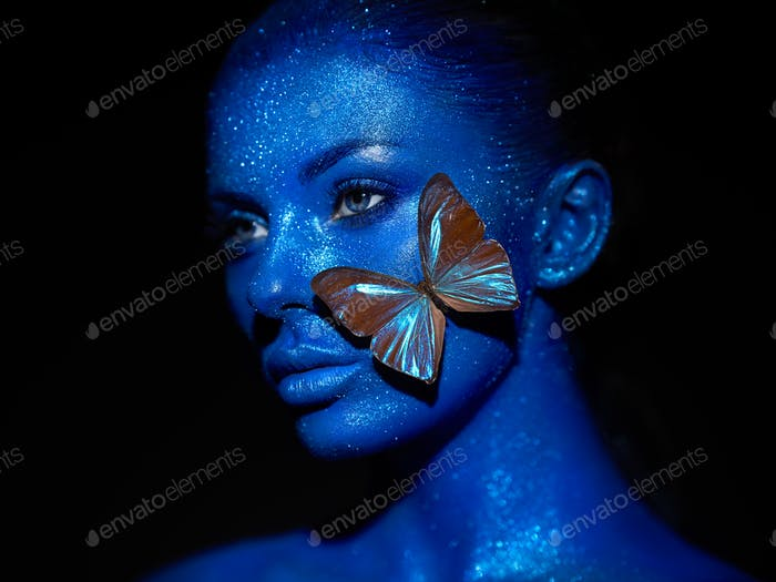 Fashion model woman with blue butterfly