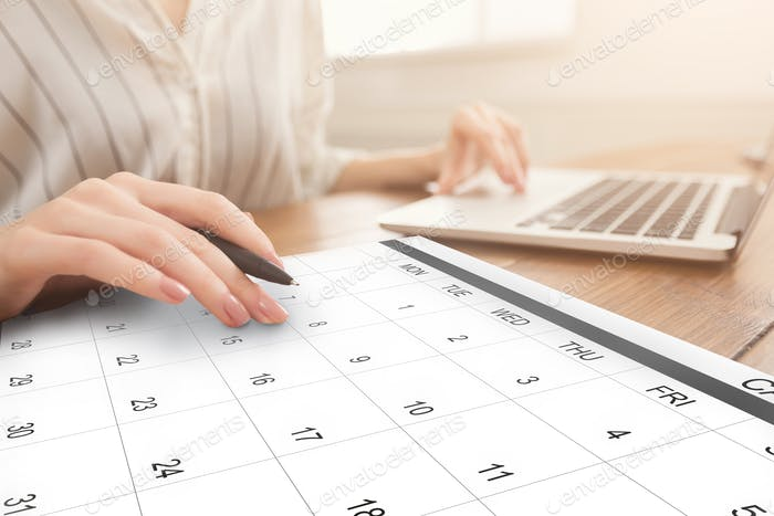 Business Scheduling. Unrecognizable Woman Working On Laptop And Checking Calendar At Workplace