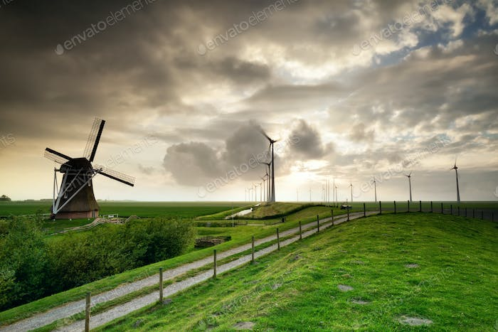rural road by old and modern windmills