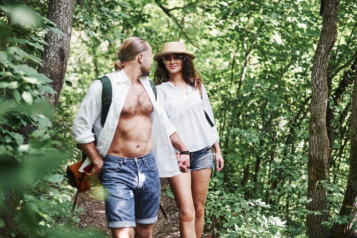 Pair of people exploring the local forest in the mountains searching for adventures
