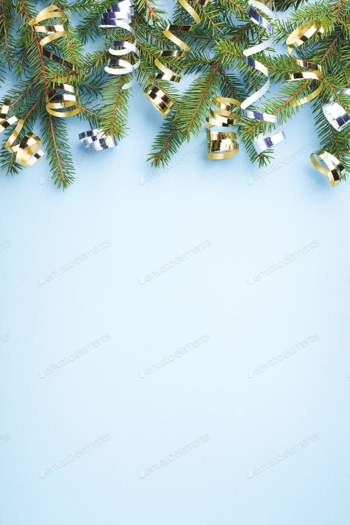 Blue Vertical Christmas Background with Fir Branches.