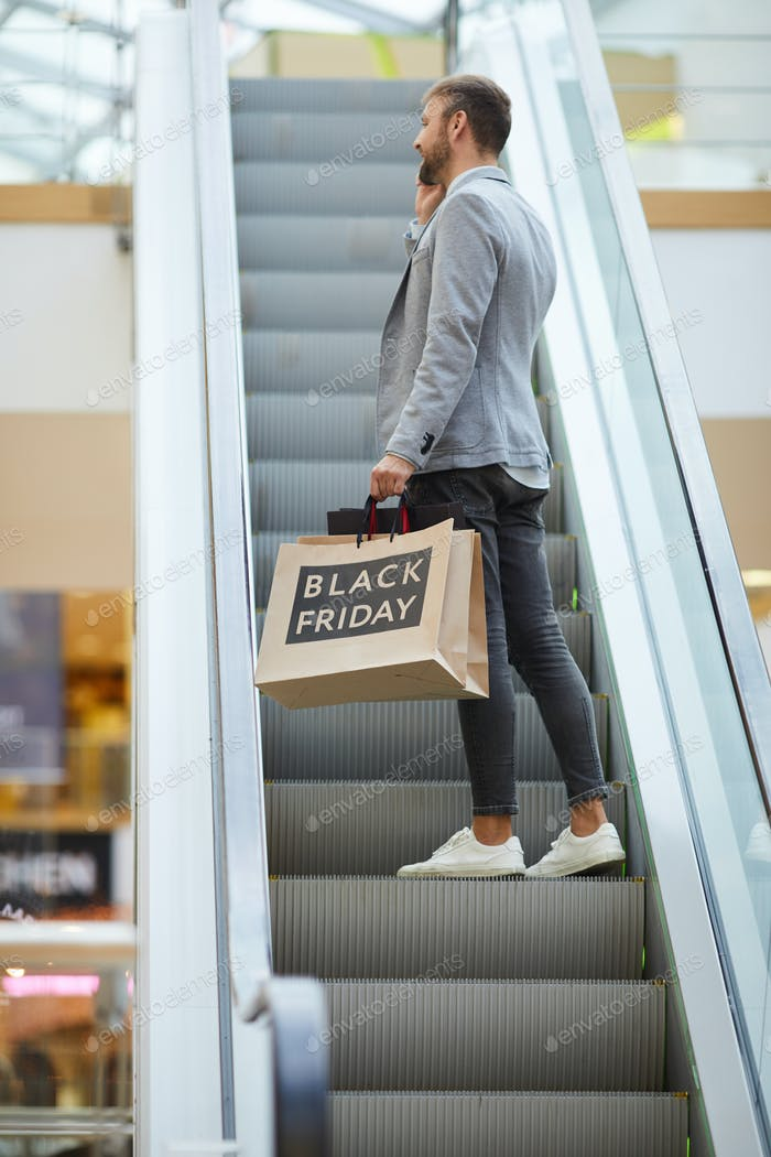 Stylish Businessman Shopping in Mall