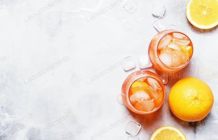 Orange Cocktail With Aperitif, Ice, Sparkling Wine And Orange Slice