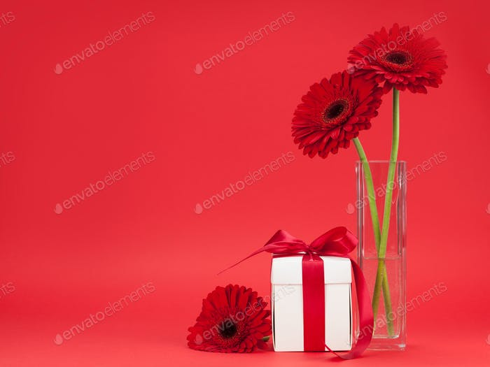 Greeting card with gerbera flowers and gift