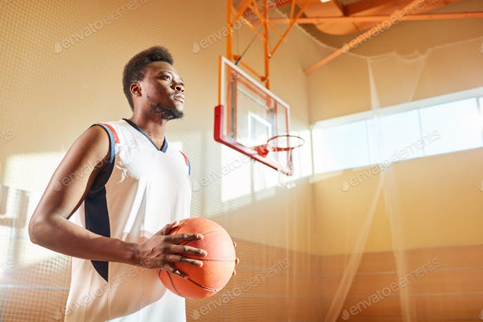 Confident sportsman on basketball court