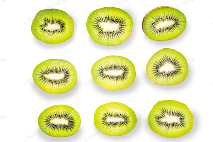Pattern of kiwi slices on the white background