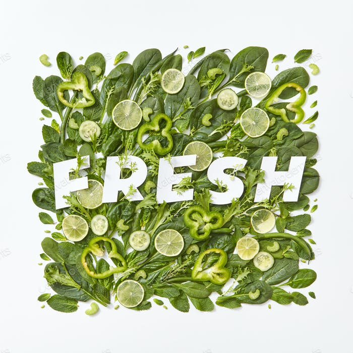 Fresh spinach, cabbage, asparagus pieces of pepper, cucumber and flower petals on a gray background