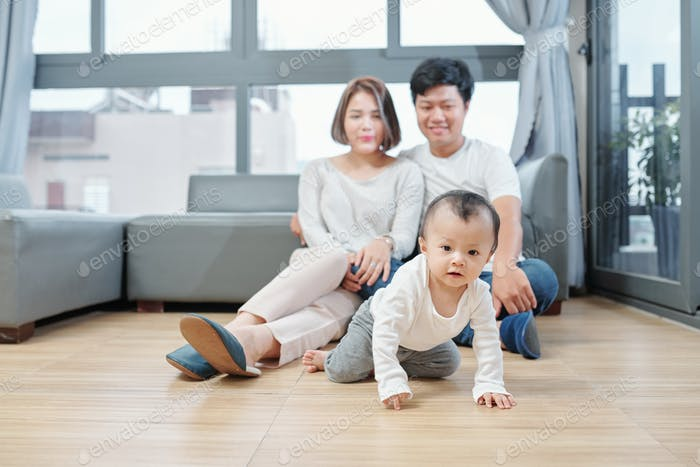 Parents and crawling baby