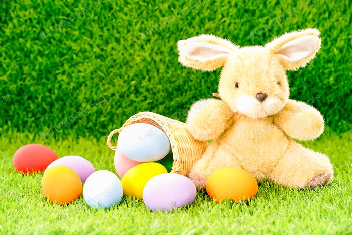 Bunny toy and Easter eggs in basket-8
