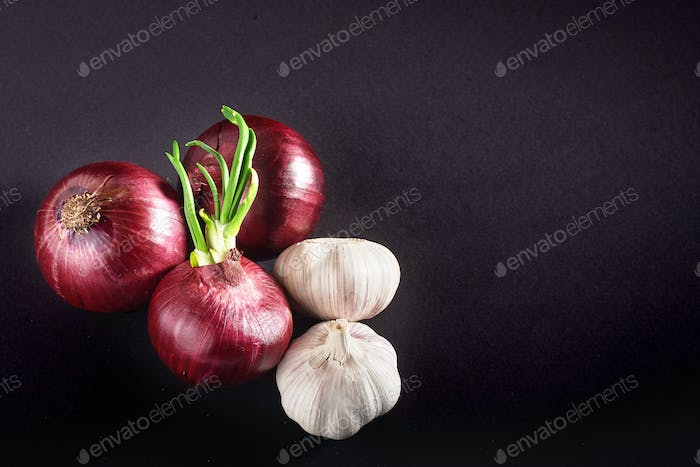 Blue purple onion and garlic isolated white on a black background