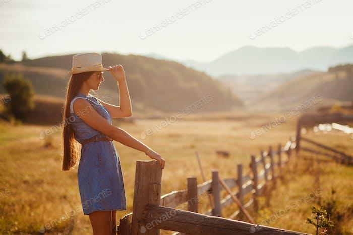 beautiful woman travel countryside at sunset