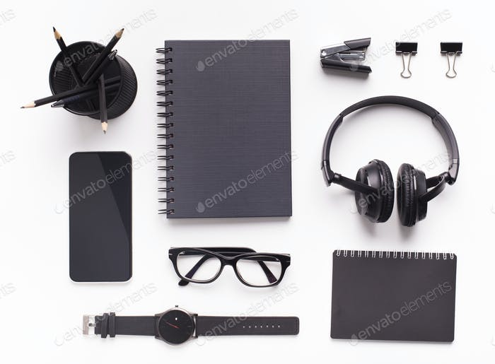 Black official style supplies, glasses and headphones, cellphone