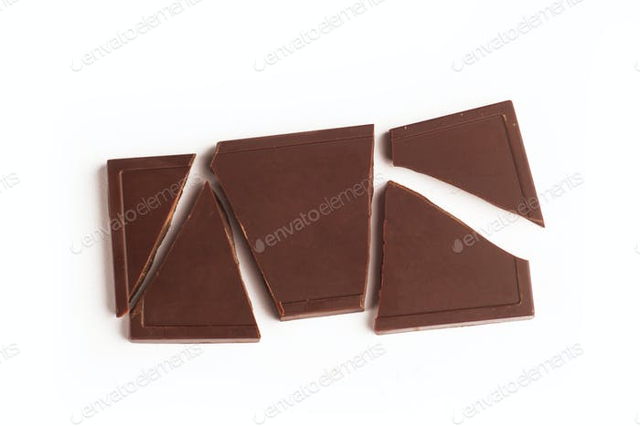 Broken dark chocolate bar on white background