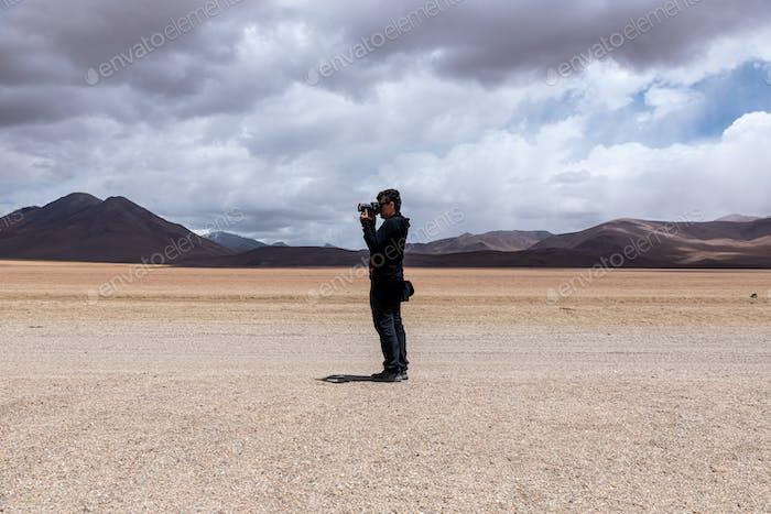 Man taking photos on Altiplano, Bolivia
