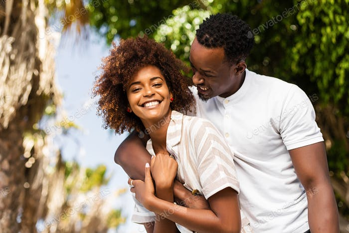 Outdoor protrait of black african american couple embracing each