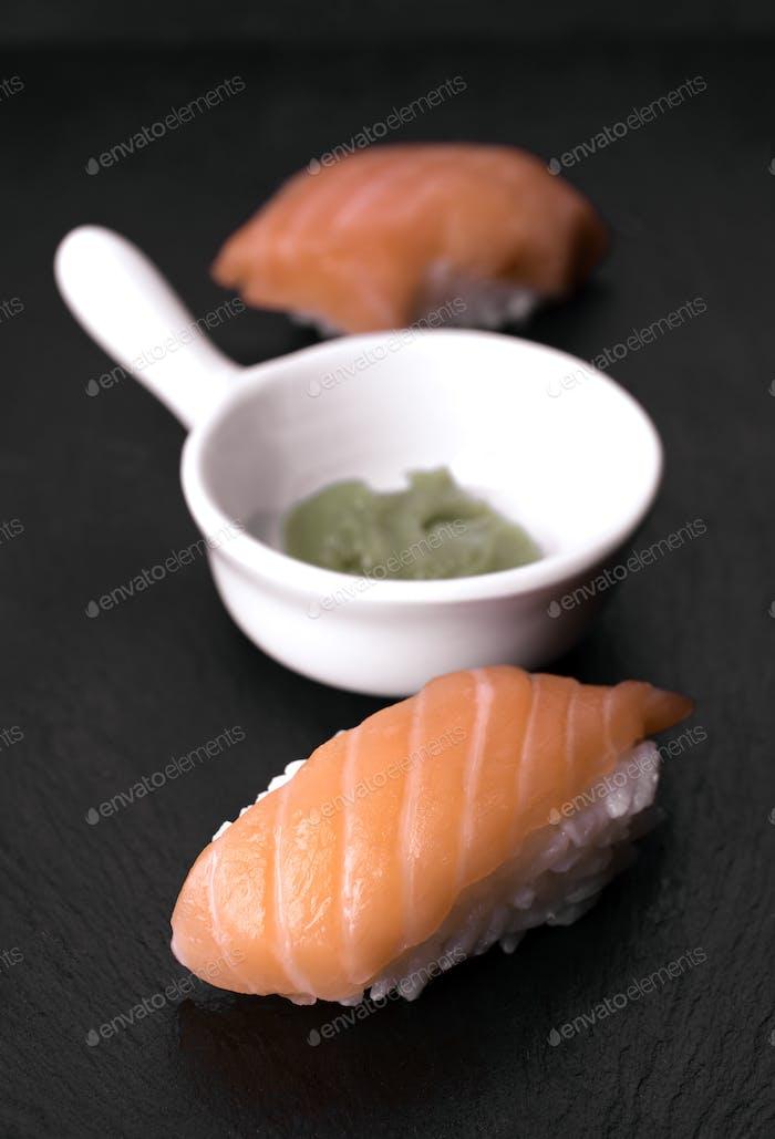 sushi on black stone