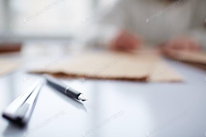 Pen on table