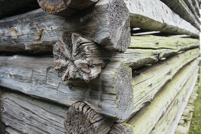 Thumbnail for Close up of a log cabin with weathered wooden logs fitted closely together.
