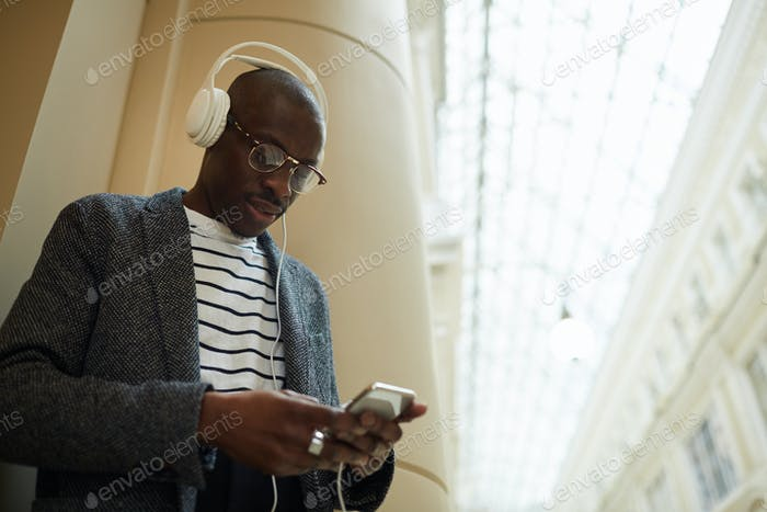 Trendy African Man Wearing Headphones