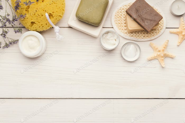 Spa background with facial mask and cream on white wood