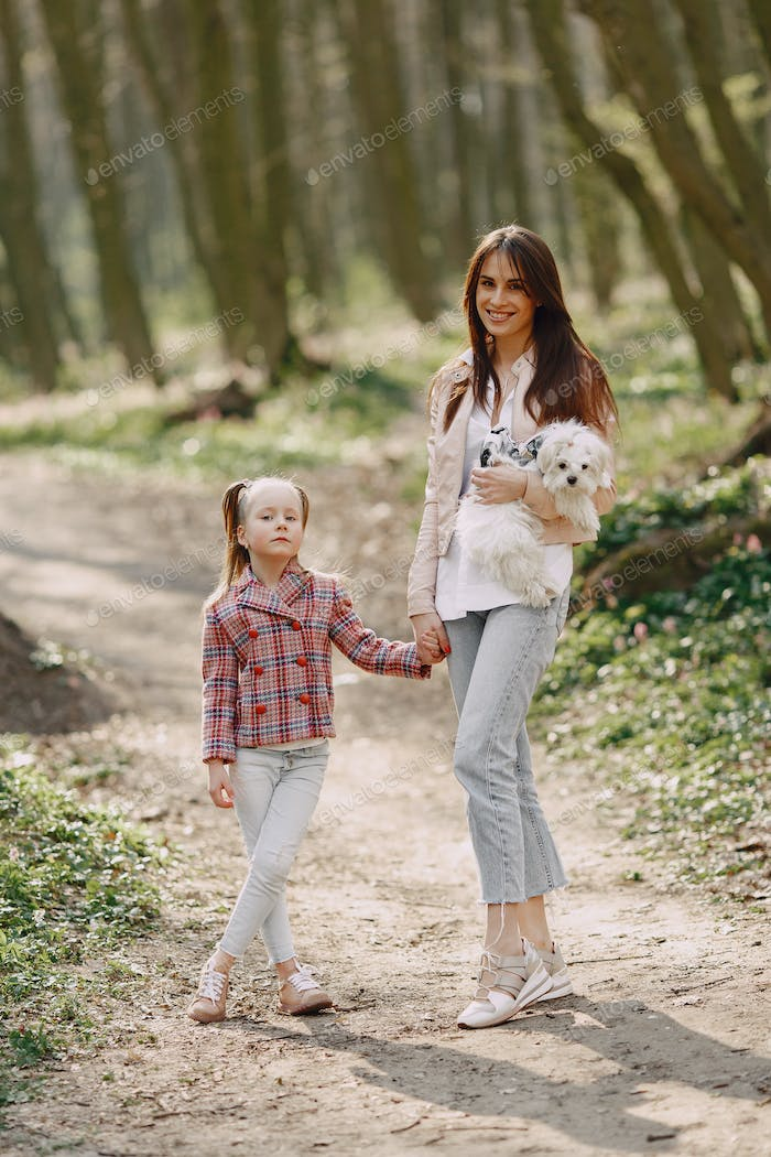 Thumbnail for Mother with daughter in a spring forest with dog