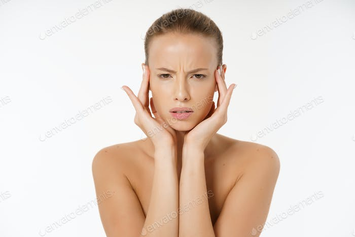 Close-up Of Worried Woman Looking At Pimple On Face