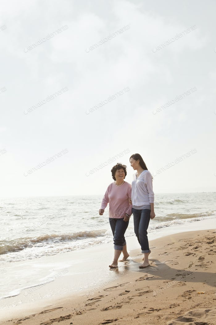 Grandmother and Granddaughter Taking a Walk by the Beach