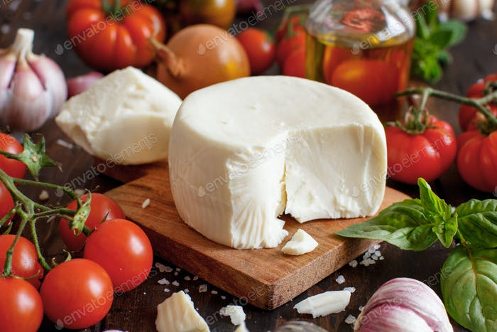South Italian cheese cacioricotta with vegetables, herbs and olive oil
