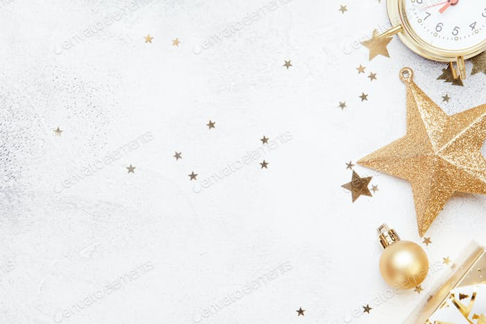 Christmas or New Year composition, gray background with gold Christmas decorations