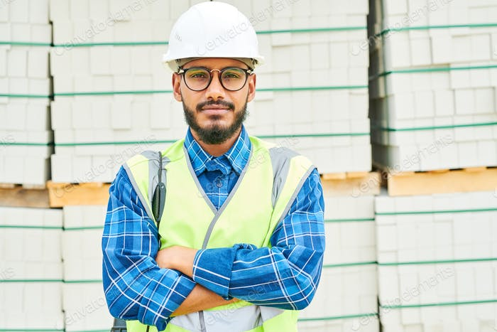Positive engineer near building materials