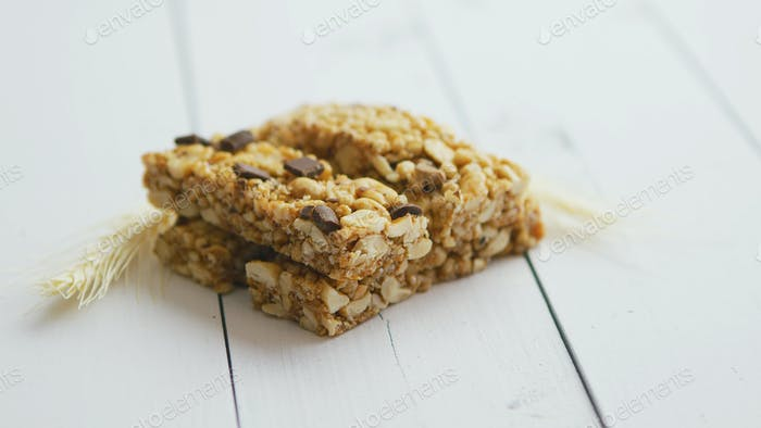 Granola bars with dried fruits wooden background