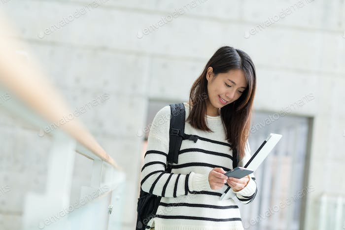 Woman use of mobile phone in university