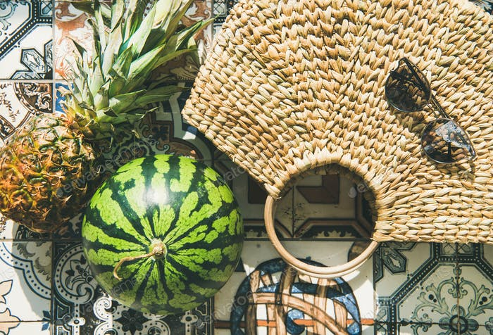 Summer lifestyle background with fruits and straw bag, close-up