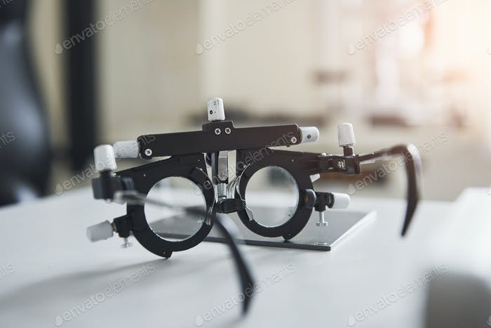 Special ophthalmologist device on the table in beautiful white room