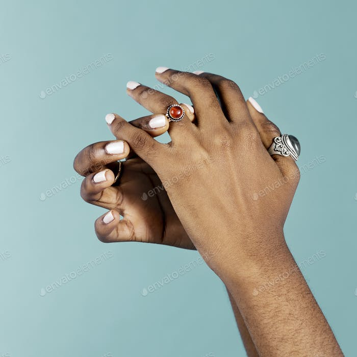 Feminine hands wearing rings