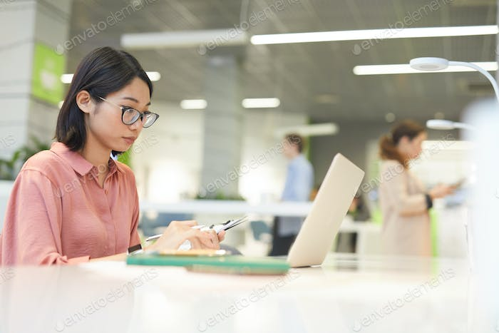 Asian Young Businesswoman Using Computer in Office