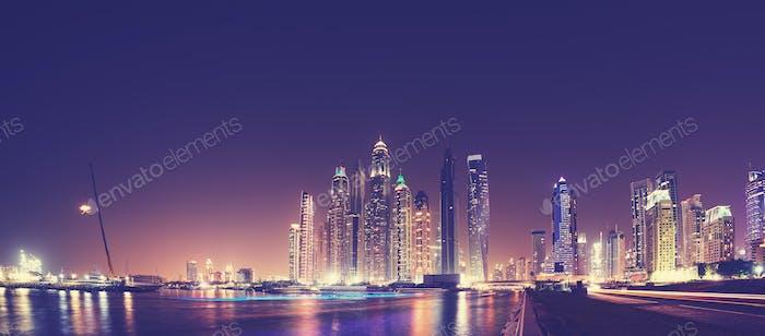 Fisheye lens panoramic picture of Dubai waterfront skyline.