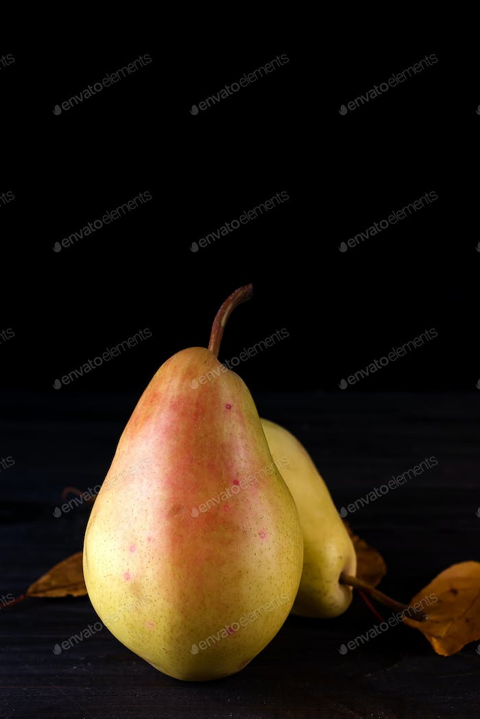 pear orchard fresh ripe pears on dark wooden background