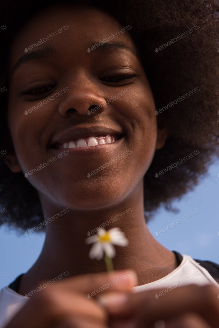 portrait of African American girl with a flower in her hand