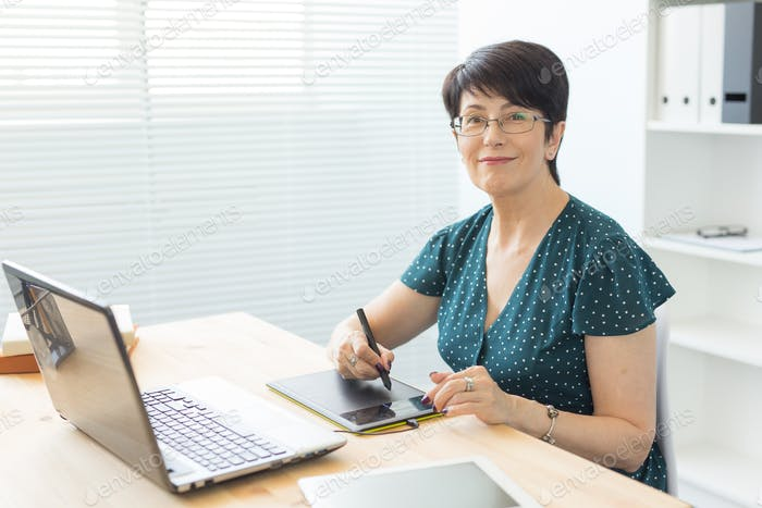 Business, technology and people concept- woman use stylus in working at laptop