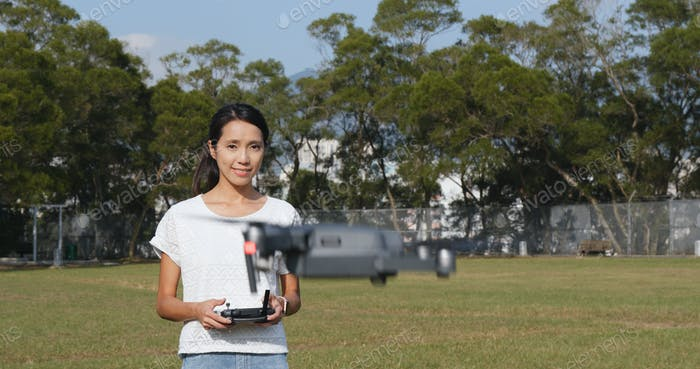 Woman control fly drone