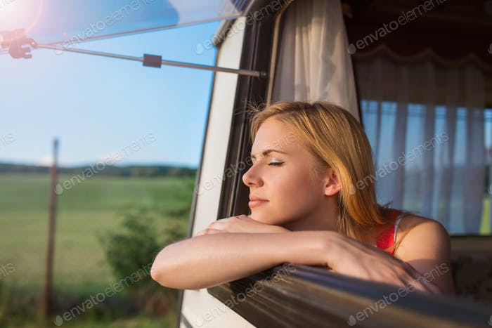 Beautiful woman in a camper van