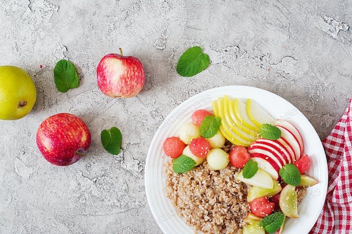 Buckwheat or porridge with fresh melon, watermelon, apple and pear.