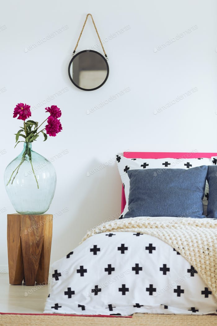 White wall and patterned bedclothes