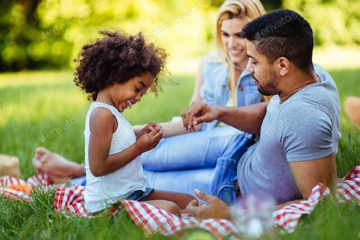 Happy family having fun time on picnic