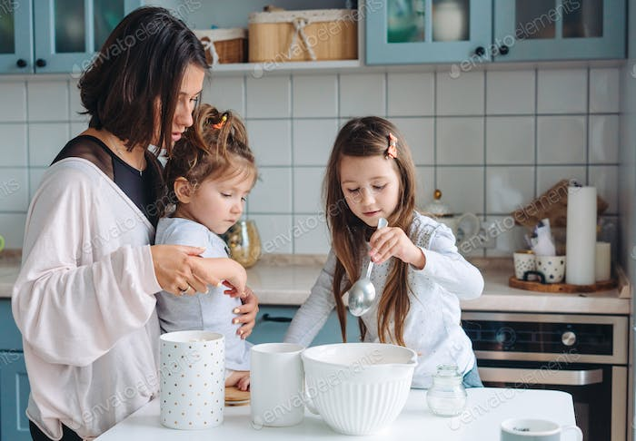 Happy family cook together in the kitchen