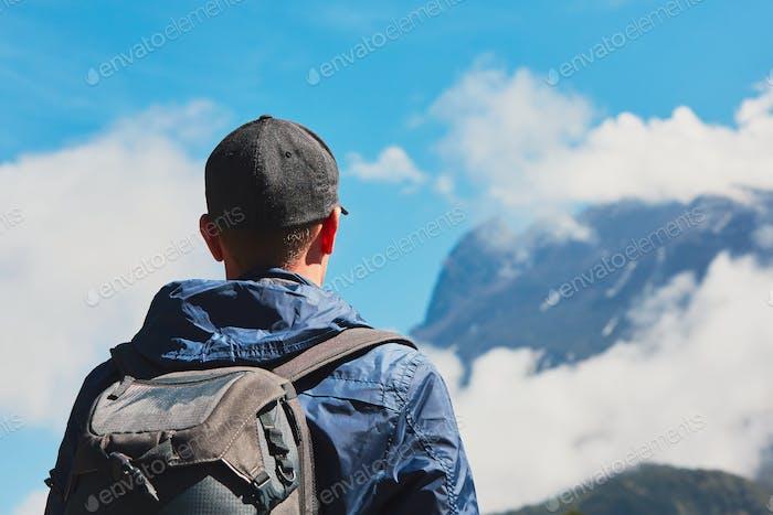 Traveler in mountains
