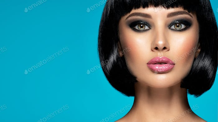Glamour fashion model with black gloss make-up.